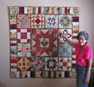 Delma with wall quilt -- 7-18-14