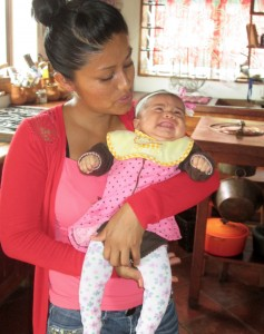 Young Mexican mother with her baby, Isabella