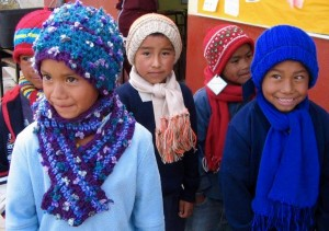 Some of the campo kids wearing their new, handmade hats and scarves