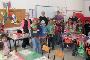 BEAUTY: darling campo kids in their classroom modeling the handmade hats and scarves we brought to them this week