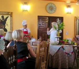 Wendy giving her floral design demonstration at the Mujeres en Cambio luncheon