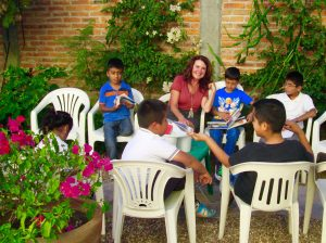 Director Linda Curran with students in the school's courtyard